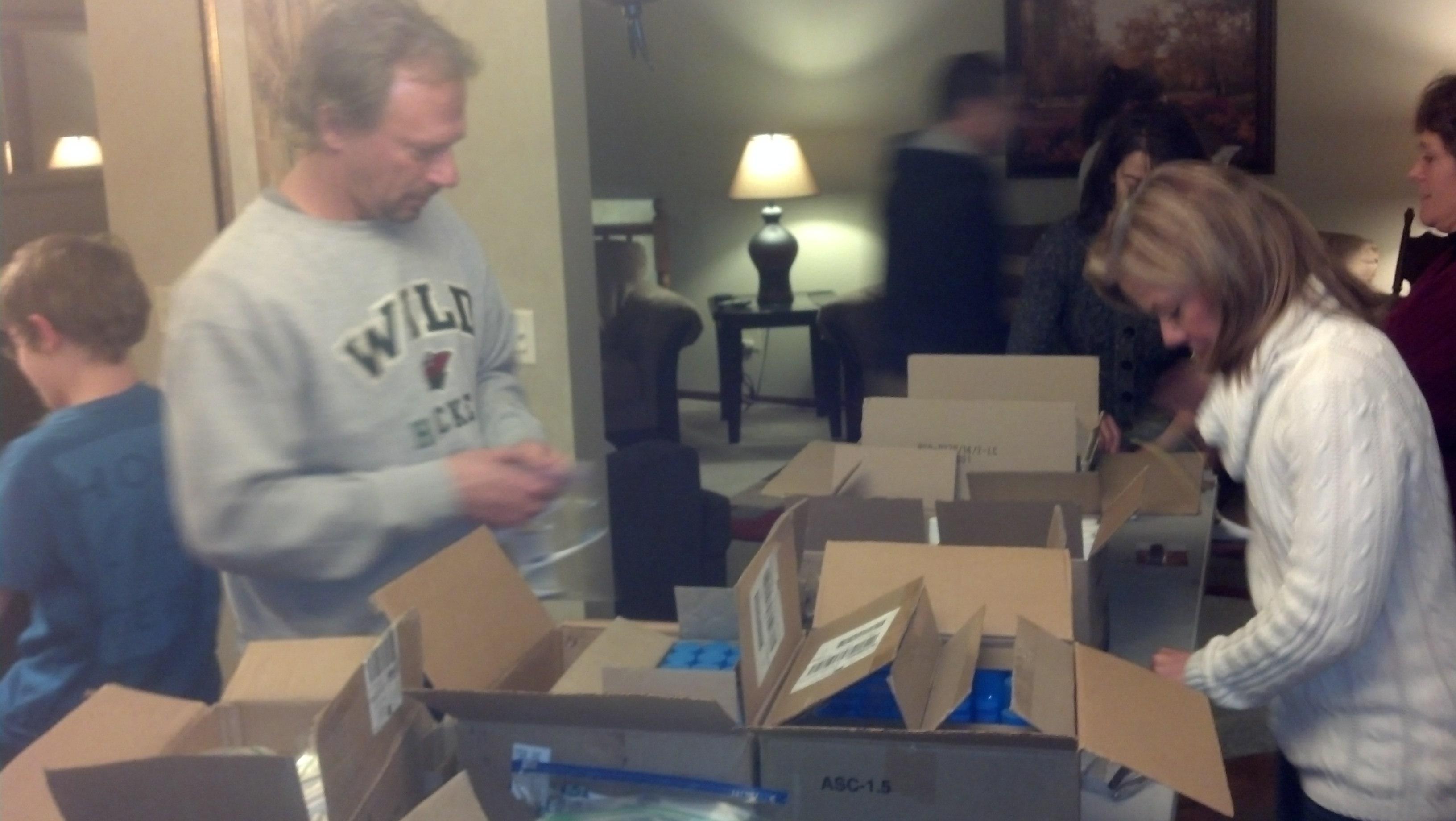 Volunteers packing pc kits 2014